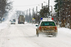 Police car. A police car on patrol on a winter day Stock Image