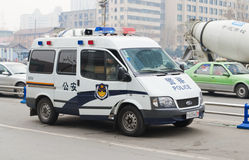Police car. Police man on duty and police car on the road at chengdu,sichuan,china Royalty Free Stock Photos