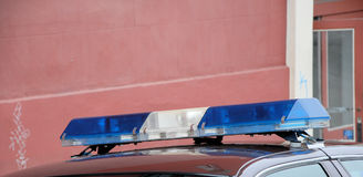 Police car. Top of a police car with blue lights Stock Photography
