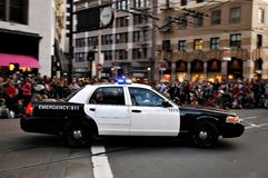 Police Car. Driving in a parade with a crowd watching Royalty Free Stock Photos