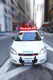 Police car. Speeding American police car with lights on Stock Photos