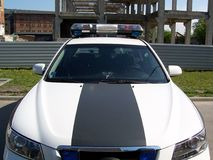 Police car. Latvian police car , near the ruins of some old building Royalty Free Stock Image