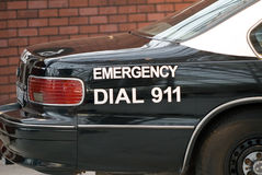 Police car. With the emergency number Royalty Free Stock Photography