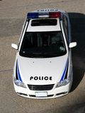Police Car. A white car with the word police written on the hood Stock Photography