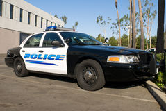 Police car. A new police car sitting in a parking lot awaits a driver Royalty Free Stock Photos