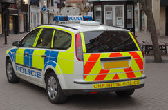 Police Car. Side on at the scene of a public disturbance Royalty Free Stock Images