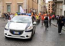 Police car on bicycle race Royalty Free Stock Photography