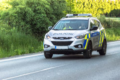 Police car in action Stock Photos