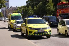Free Police Car And Ambulance In City Street With Traffic Royalty Free Stock Photo - 125034925