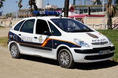 Police car by beach, Malaga, Spain. Royalty Free Stock Images