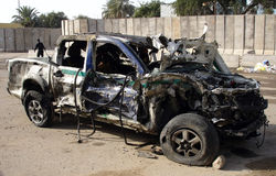 Police car blasted by car bomb. Police car which was blasted by a nearby car bomb detonation Royalty Free Stock Photography