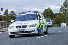 Police car with a blue light flashing. A police car with blue strobe lights flashing on a motorway precedes the runners in the Great North Run, Newcastle upon Royalty Free Stock Photography