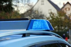 Police car with blue light siren. On spot in the street royalty free stock photos