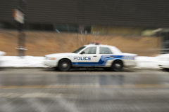 Police car blur effect in american city. Present at crime scene Royalty Free Stock Photography