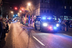 Police car and Boy Scout troop lead holiday parade in Oregon Stock Photography
