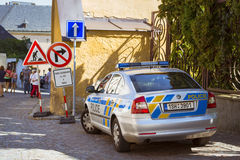 A police car of brand Skoda in the charming street with old hauses in Kutna Hora Royalty Free Stock Photos
