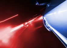 Police car chase by night blured motion. Speedy driving by night. Police Car chase Stock Photo