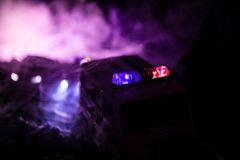 Police car chasing a car at night with fog background. 911 Emergency response police car speeding to scene of crime. Selective focus royalty free stock images