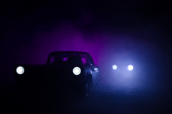 Police car chasing a car at night with fog background. 911 Emergency response police car speeding to scene of crime. Royalty Free Stock Photo
