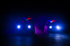Police car chasing a car at night with fog background. 911 Emergency response police car speeding to scene of crime. Selective focus Stock Images