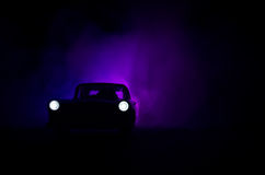 Police car chasing a car at night with fog background. 911 Emergency response police car speeding to scene of crime. Royalty Free Stock Images