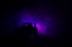 Police car chasing a car at night with fog background. 911 Emergency response police car speeding to scene of crime. Stock Image
