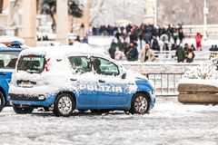 Police car covered by snow in Rome in Italy. ROME, ITALY. February 26, 2018: Police car covered by snow in Rome in Italy. Extraordinary wave of bad weather and royalty free stock image