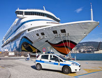 Police car and cruise ship at Trieste harbor Stock Image