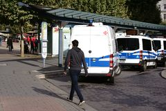 Police car Day of German Unity. Mainz, Germany - October 03, 2017: Police car at a bus stop station on the day of German Unity on October 03, 2017 in Mainz Stock Images