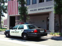 Police Car and Dept. Police car parked in front of Police Dept office.  Baldwin Park, CA.  City names removed. Place your own officer in front of car Stock Photography
