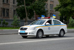 Police car. In Dnepropetrovsk, 23 August, celebrate Flag Day. All residents are located on street with yellow-blue flag of Ukraine. On the streets of conduct Royalty Free Stock Images