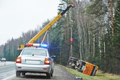 Police car with a flasher at lorry crash Stock Photos