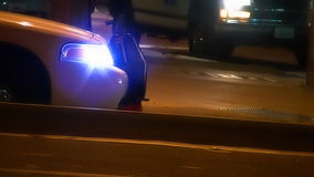 Police car with flashing strobe light on street