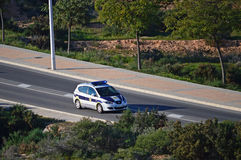 Police Car. A Police car heading towards a bush fire in Gran Alacant Spain Stock Photography