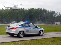 The police car and the helicopter of the emergencies Ministry on the ground of Noginsk rescue center. NOGINSK, RUSSIA - JUNE 6, 2017:The police car and the stock photo