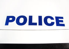 Police on car hood Stock Photography