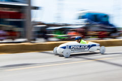 Police Car. Hopkinsville Police sponsored entry in a Soap Box Derby. Panned shot showing motion Royalty Free Stock Images