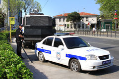 Police Car. ISTANBUL - MAY 1: Many people can't take part in May Day march on May 1, 2013 in Istanbul. Police blocked all the ways to Taksim Square to prevent Royalty Free Stock Images