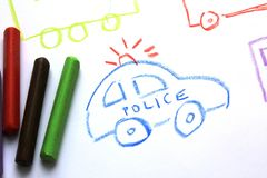 A police car on the kid`s drawing. Oil pastels crayons colorful art drawing on white paper background royalty free stock images