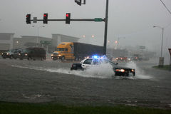Police Car Lights. A Joplin, Missouri police car travels through a flooded intersection Stock Photography