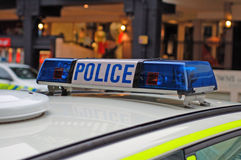 Police Car Lights. Close up of blue lights on top of a UK police car Royalty Free Stock Image