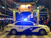 Police Car with Lights Flashing. A Chinese police car with blue lights flashing royalty free stock images