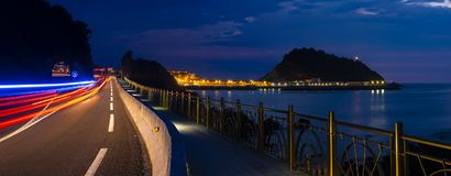 Police car lights flashing on the road at night. Getaria, Basque Country stock image