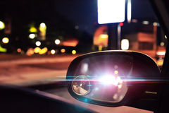 Police Car Lights Reflected On The Rearview Mirror Of A Parked C Stock Photo
