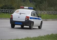 Police car with lights the road Royalty Free Stock Photos