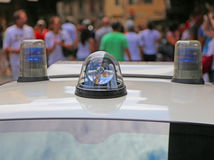 Police car with lights and siren in the city. Full of people stock images