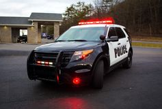 Police car with lights and siren on street. Emergency Stock Photos