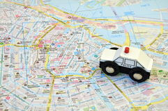 Police car on the map of the city Royalty Free Stock Image