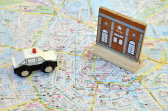 Police car on the map of a city Stock Photo