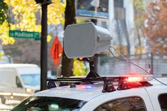Police car with a megaphone mounted royalty free stock images